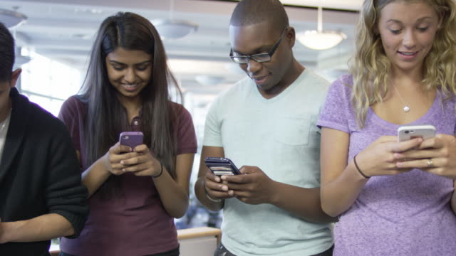 Young adults on their cell phones video