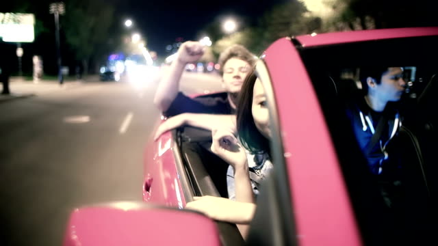 Young adults ride in a convertible during summer video