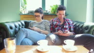 Young adults using phones these days. video