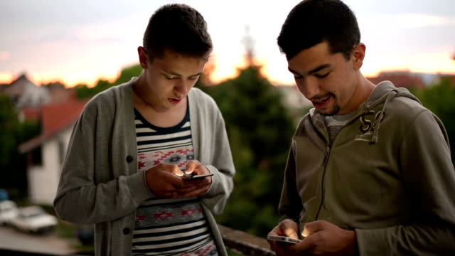 Young adults with phone video