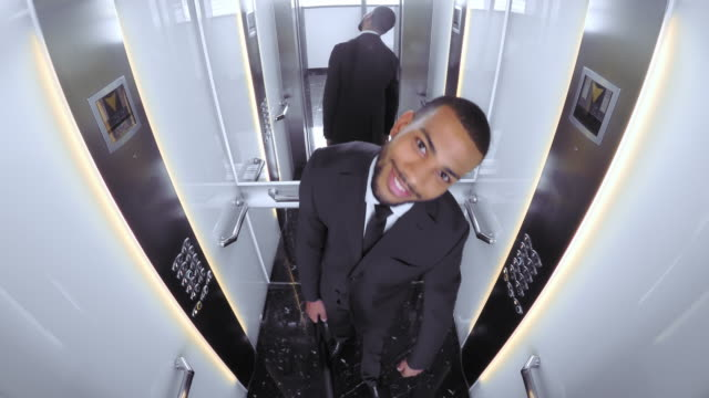 POV Young African American business man entering elevator video