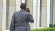 young African American business man with mobile phone - Black people, slow motion video