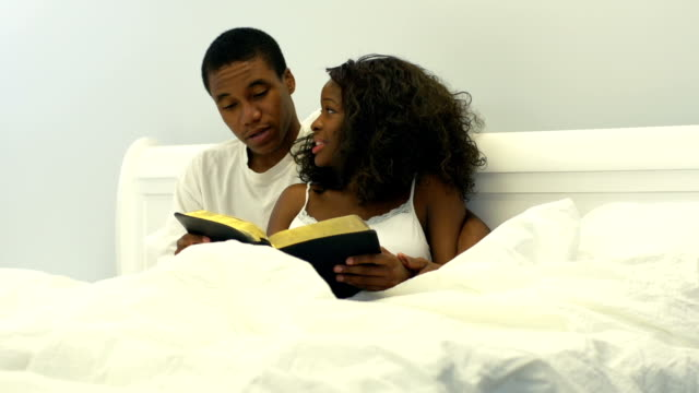 Young African American couple in bed video
