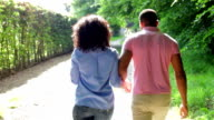 Young African American Couple Walking In Countryside video