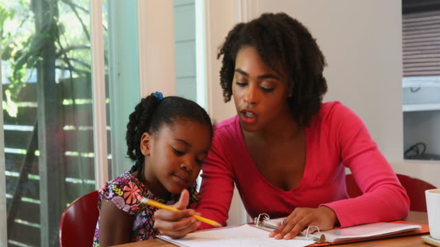 Young African American Family Doing Homework Together video