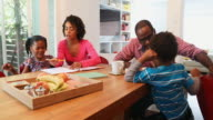 Young African American family eating healthy snacks together video