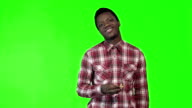 Young african man eating french fries video