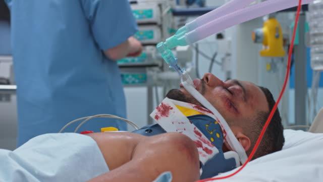 Young African-American male on breathing support in ICU video