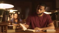 DS Young African-American man studying in library video