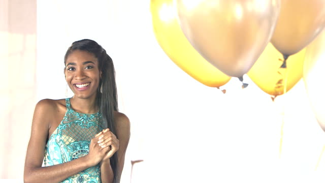 Young African-American teenage girl wearing prom dress video