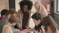 Young African-American Woman Leads Multi-Ethnic Team Meeting CU video