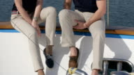 Young and beautiful couple on yacht. video