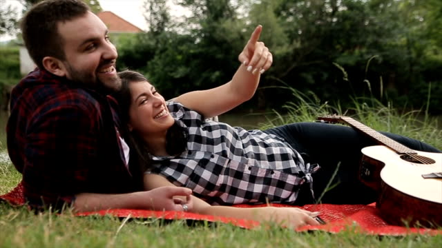 young and beautiful couple relaxing in the nature video