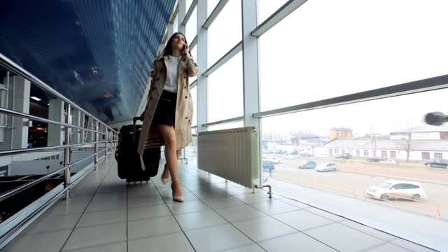 Young and beautiful woman is walking airport hall video
