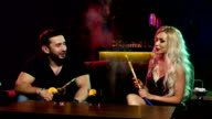 young and sexy people smoking hookah in the lounge caffee video