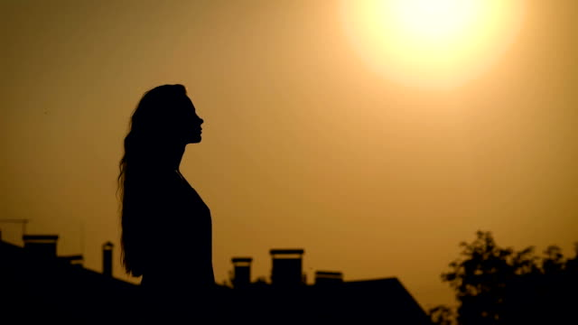 Young and unbelievebly beautiful woman, goes alone for a stroll in field to enjoy one of the last summer sunsets video