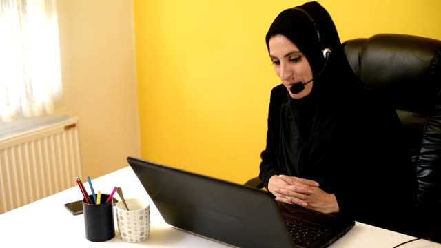 Young arab businesswoman having a video conference with clients. video