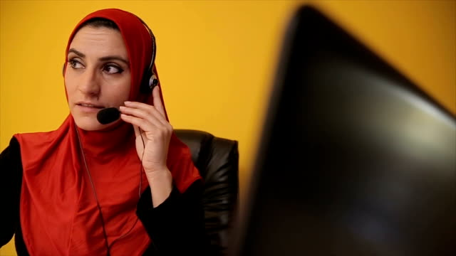 Young Arab woman Operator  in call center video