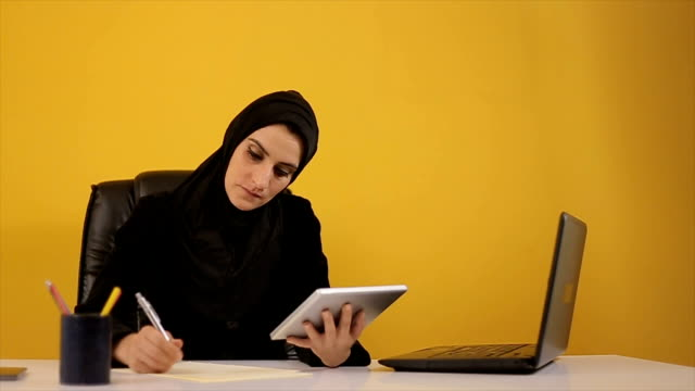 Young Arab woman using tablet in the office video