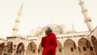 Young Arabian Woman wearing Veil in front of a Mosque video