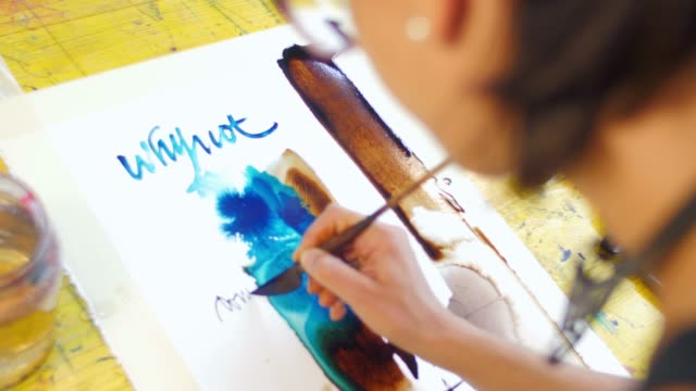 Young artist creating artwork in her atelier video