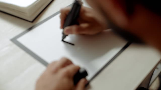 Young artist draws in studio video