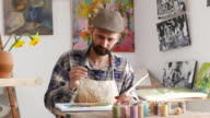 4К Young artist painting in workshop video