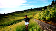 young asia female walking in Lavaux vinyard video