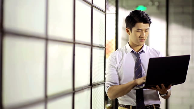 young asian business man working in office video