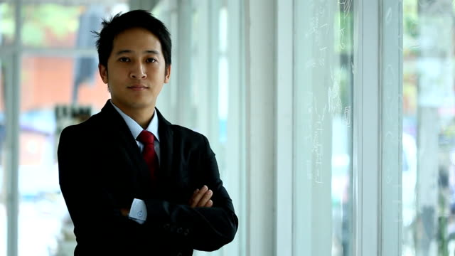 Young Asian businessman stands video