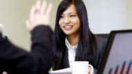 Young Asian businesswoman in meeting video