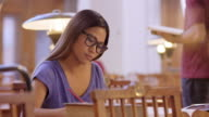 LD Young Asian female student studying in library video