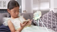 Young Asian Girl Playing Game On Mobile Device Shot On R3D video