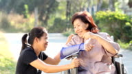 Young asian is taking care the senior woman video