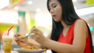 Young Asian Lady eating Pad Thai in cafe video