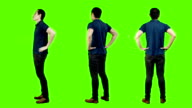 Young asian man casual standing,green background. video
