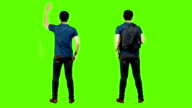 Young asian mans from the back,green background. video