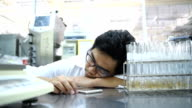 Young Asian men scientist sleep in laboratory video