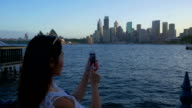 Young Asian tourist taking pictures of Sydney video