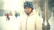Young Asian Woman in winter park slowmotion video