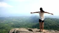 young asian woman practice yoga on mountain peak rock video
