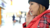 Young asian Woman talking on cell phone video