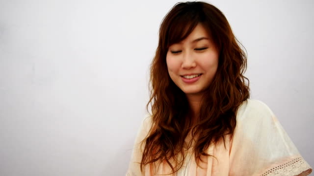 Young asian woman with typical welcome expression video