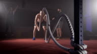 Young athlete doing exercise with rope video