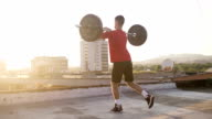 Young Athletic Man Doing Weighted Lunges video
