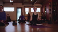 Young attractive blonde attending a yoga class video