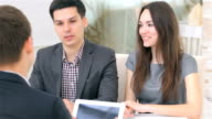 Young attractive couple consults about their business project video