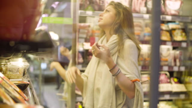 Young attractive woman in a supermarket video