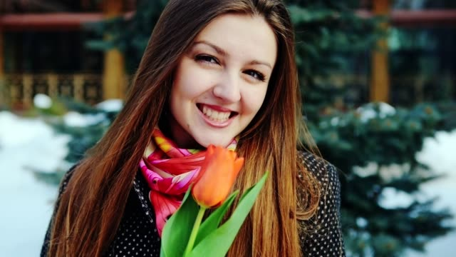 Young Attractive Woman Smelling Spring Tulip video