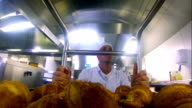 Young baker pushing a trolley of croissants video